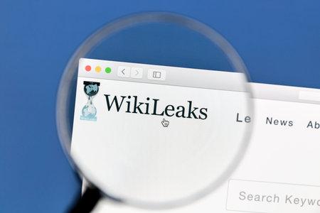 wiki: Closeup of WikiLeaks website website under a magnifying glass. WikiLeaks is an international non-profit organisation that publishes secret information