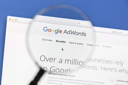 Google Adwords website under a magnifying glass Editoriali