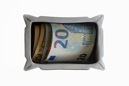 Money - dollars, euros and other currencies are in the box isolated on white background. Stockfoto - 107406716