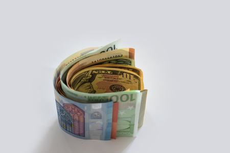 Money - dollars, euros and other currencies lie on the white surface of the table Stock Photo