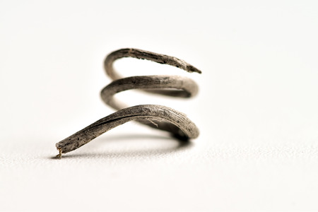 Abstract photographs of a dried mustache of a vine (curled vine tendrils) can be interpreted as problems of irrigation water or the extinction of life, or as a kind of spiral element