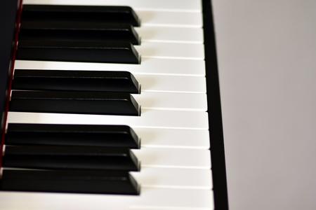 Keys of a digital piano, soft focusing, creative mood. Midi piano keyboard for playing digital music and making remixes. 写真素材