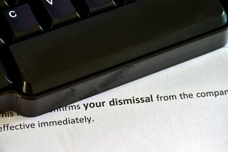 Receiving a Dismissal Letter on the desktop Фото со стока