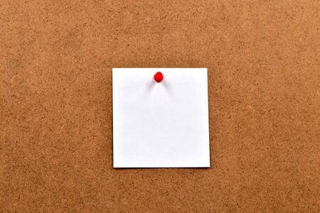 White blank sheet of paper attached to the chipboard with a push button