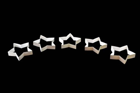 Star symbol, hand made from cardboard, the concept of a positive or negative rating, reviews and feedback, isolated on black background