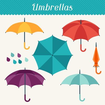 평면 디자인 스타일에 귀여운 여러 가지 빛깔의 우산의 집합입니다.