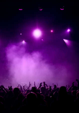 Black Concert Crowd and violet Light Stock Photo - 4363168