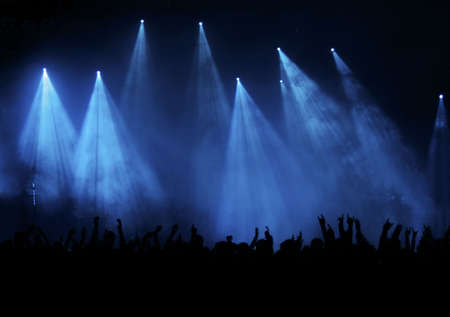 cheering fans: Black Concert Crowd and elegant blue Light