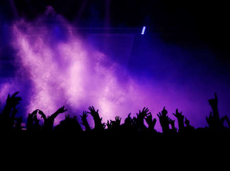 Black Concert Crowd and Violet Light Stock Photo - 4383972
