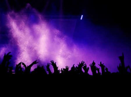 Black Concert Crowd and Violet Light