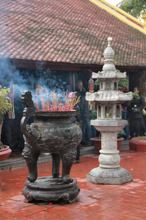 smudge: Smudge sticks smoking in a Vietnamese temple.
