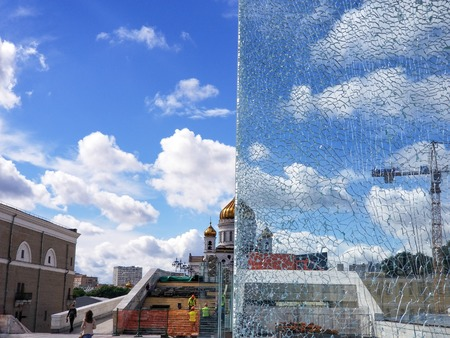 Moscow, Russia - July 2018: Half view through broken glass of Cathedral of Christ the Saviour.