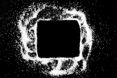 Empty square checking box symbol drawing by finger on white snow salt powder spot cloud in center on black background. Tick concept with place for text. Copy space.