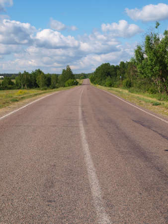 Long-distance road stretches to the horizon    Stock Photo