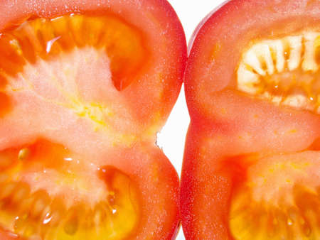 Thin slices of ripe red tomatoes, close-up