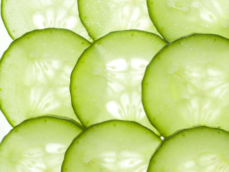 Slices of cucumber on white background