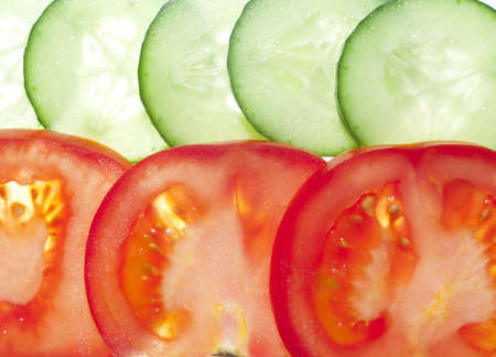 Sliced ​​tomato and cucumber slices on clearance Stock Photo