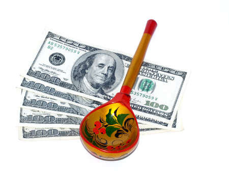 Russian painted spoon against the U.S. dollar