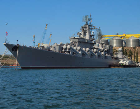 Warship docked in the port on a sunny day  Stock Photo