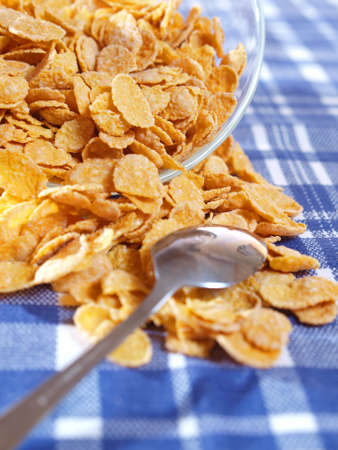 Cornflakes and milk on the table out of the blue tablecloth  Light breakfast
