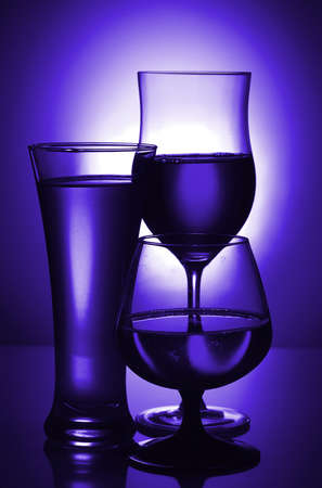 Silhouettes of glasses in blue. Toning.