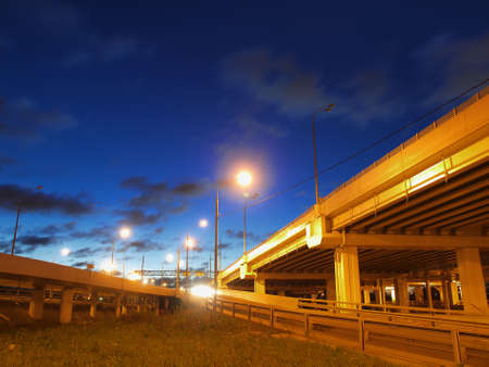 Road overpass at night with backlight  photo