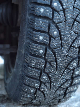 studded tire on the winter ice road       photo
