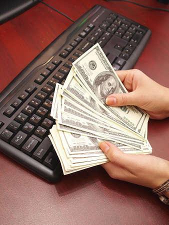Women s hands and money
