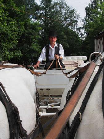The driver controls the white crew