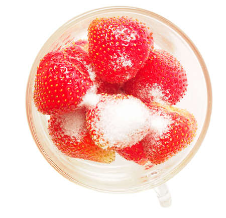 Fresh strawberries with sugar on white background