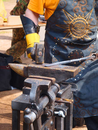 Blacksmith is working for an anvil Stock Photo