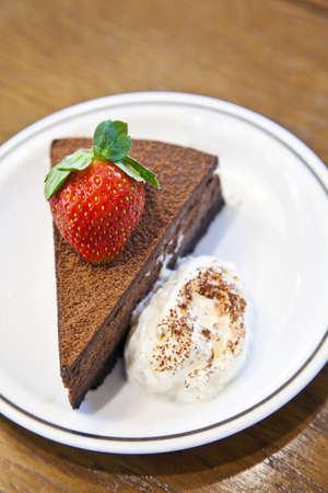 chocolate truffle: Chocolate truffle with strawberry and cream Stock Photo