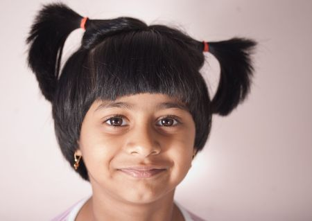 portrait of a child giving a smile with cute little pony  Stock Photo - 6400389
