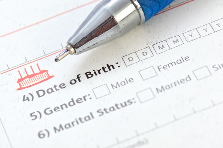 An application form showing date of birth information text along with ball pen. Stock Photo - 9402609