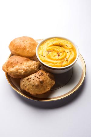 Amrakhand OR Mango Shrikhand with puri or Poori Imagens