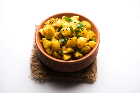 Chatpate Masala Aloo Sabzi fry OR Bombay potatoes served in a bowl, selective focus Reklamní fotografie