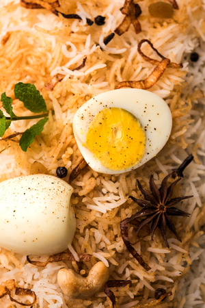 Egg Biryani - Basmati rice cooked with masala roasted eggs and spices and served with yogurt, selective focus Stock fotó