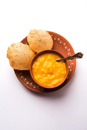 Aam Ras Puri OR Alphonso  Mango pulp with fried Poori, selective focus