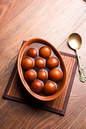 Sweet Gulab Jamun in terracotta bowl