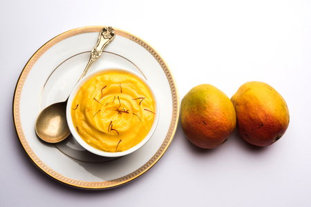 Amrakhand OR Mango Shrikhand  srikhand is popular Indian dessert served with saffron toppings in a bowl Stock Photo