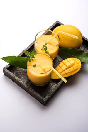 Mango Lassi, Indian popular summer drink in a terracotta glass, selective focus