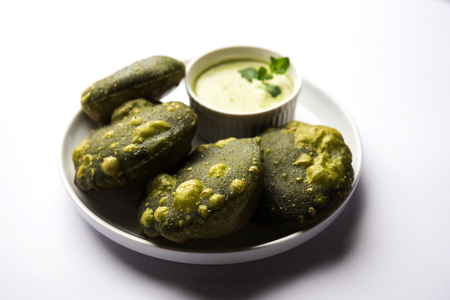 Palak Puri or Spinach Poori, indian breakfast food served with green chutney, selective focus Stock Photo