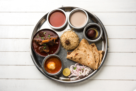 Motton Thali OR Gosht/Lamb platter is Indian/asian non veg lunch/dinner menu consists of meat, egg curry with chapati ,rice, salad and sweet Gulab Jamun