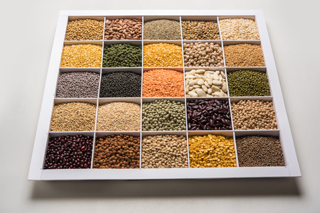Indian Beans,Pulses,Lentils,Rice and Wheat grain in a white wooden box with cells, selective focus.
