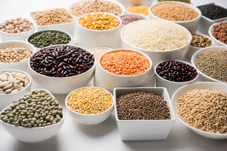 Uncooked pulses,grains and seeds in White bowls over white background. selective focus Stock fotó