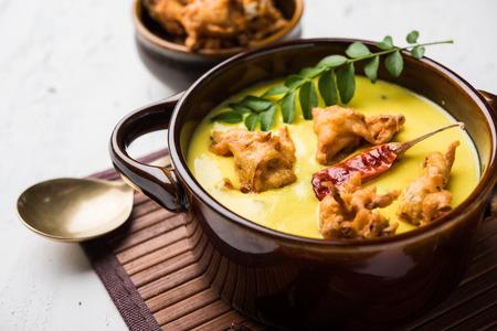 Punjabi Kadhi Pakoda or curry Pakora, Indian cuisine served in a bowl or karahi, selective focus Stock Photo