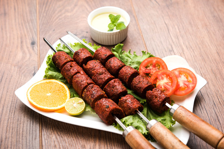 Indian Mutton Seekh Kabab served with green salad, selective focus 写真素材