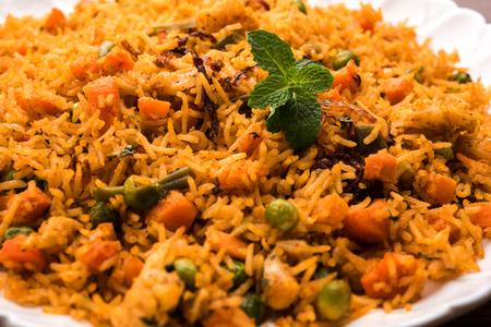 Indian Vegetable Pulav or Biryani made using Basmati Rice, served in terracotta bowl. selective focus Stock Photo