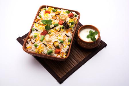 Indian Vegetable Pulav or Biryani made using Basmati Rice, served in a ceramic bowl. selective focus 写真素材