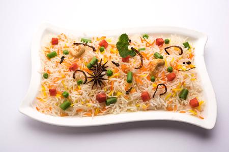 Indian Vegetable Pulav or Biryani made using Basmati Rice, served in a ceramic bowl. selective focus Stock Photo